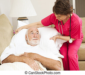 Home Health - Patient Comfort - Home health nurse fluffs an...