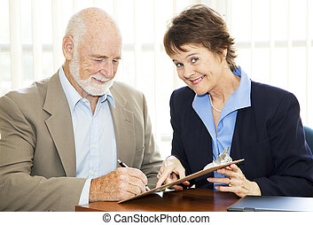 Signing Up New Client - Successful saleswoman signs up a new...