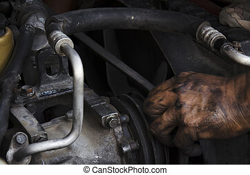 Old man 60 year old thai people professional automotive motor mechanic repair and inspecting the alternator in car