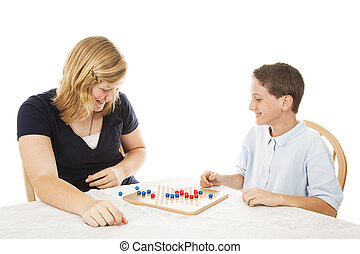 Siblings Play Board Game