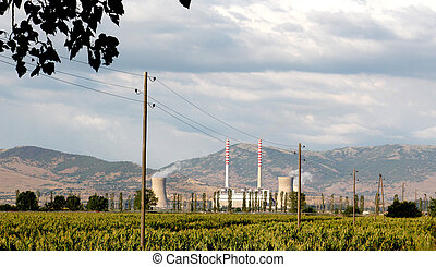 power plant with corn field - picture of a power plant with...