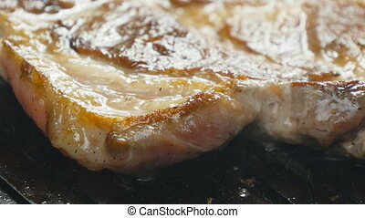 Pork chop in a frying pan grill - Pork chop with clary in a...