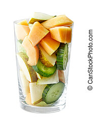 glass of fruit and vegetable pieces for making smoothie