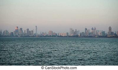 Modern city on the sea peninsula - Skyscrapes, buildings of...