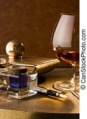 Writer\'s cognac - Fountain pen, ink and a glass of cognac