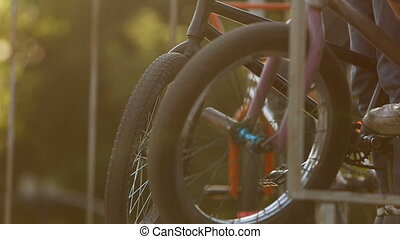 BMX wheels close up on a ramp - BMX rider does various...