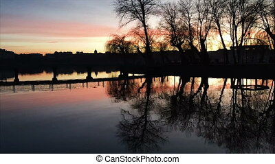 sunset on the river - beautiful sunset on a calm lake, dusk....