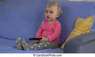 girl with remote control concentrated on television tv...