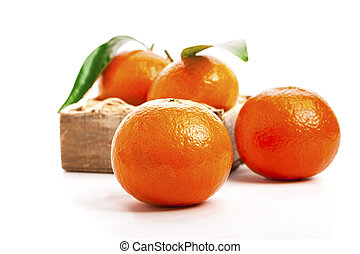 Ripe mandarines, Tangerines with leaves on a white...