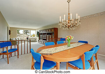 Dining room interior in American classic style with antique chandelier.