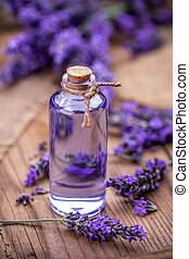 Spa massage oil and fresh lavender flowers