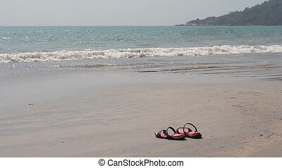 Flip Flops on a Sandy Beach - Pair if Flip Flops on a Sandy...