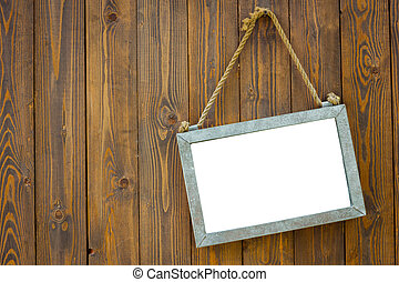 white space blackboard with rope on wooden door of a coffee...