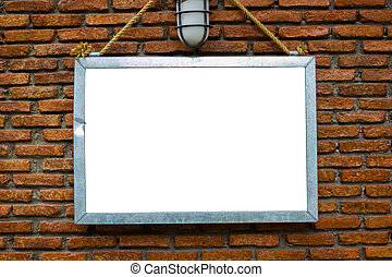 blank billboard hung on a buildings exterior brick wall,...