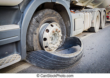 closeup damaged 18 wheeler semi truck burst tires by highway...