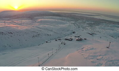 Sunrise over Ski Resort in Mountains - Bird eye view of sun...
