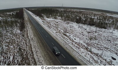 Car Driving on the Route in Winter - Aerial shot of a car...