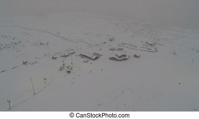 Ski Resort in Snowfall - Aerial shot of ski resort in...