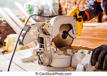 Carpenter working Man cutting plank by circular saw - Hands...