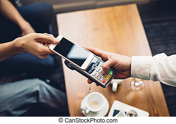 Contactless Smartphone Payment - Business man making a...