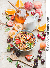 Healthy breakfast ingredients Oat granola in bowl with nuts,...