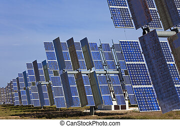 A Field of Green Energy Photovoltaic Solar Panels - A field...