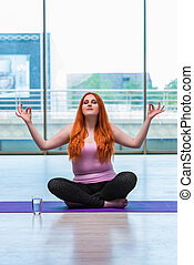 Woman in yoga concept in gym