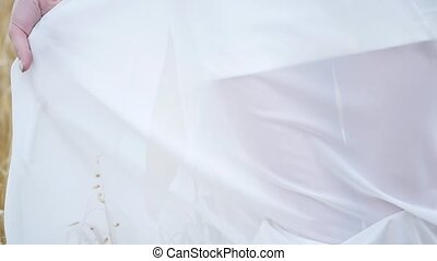 white dress billowing in the wind girl in a white dress in a...