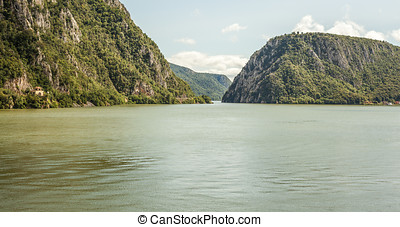 Danube river at Cazanele Mari with big rocky mountains