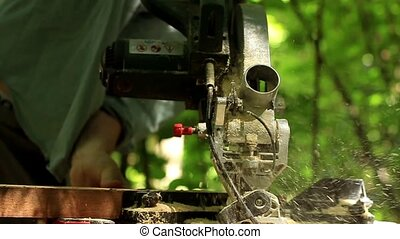 Carpenter working with Industrial tool in wood factory,...