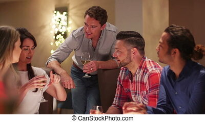 Friends enjoying a Drink - Group of friends talking in a...