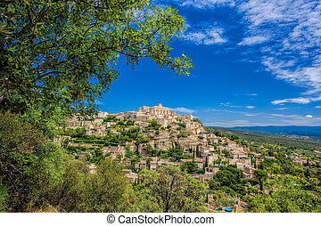 Famous old village Gordes in Provence against sunset in...
