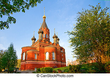 Red church - Red stone orthodox church with black cupolas,...