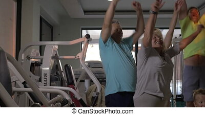 Excited family in the gym - Big happy family with child...
