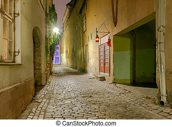 Tallinn The streets at night - Old traditional street with a...