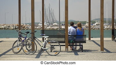 Couple with digital tablet on waterfront