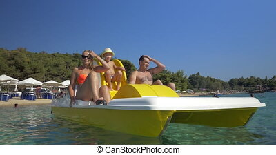 Family with child enjoying pedal boat ride - Mother, father...