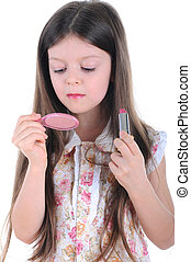 Little girl with a mirror and lipstick