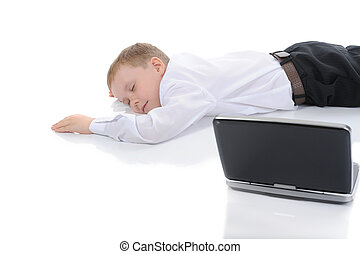 little boy fell asleep in front of a laptop. Isolated on...