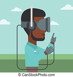 Man in virtual reality headset playing video game.