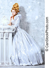 fairy light - Elegant young woman in a lush white medieval...
