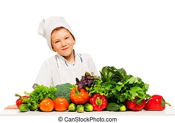 Happy kid preparing healthy vegetables meal