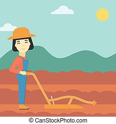 Farmer on the field with plough - An asian female farmer...