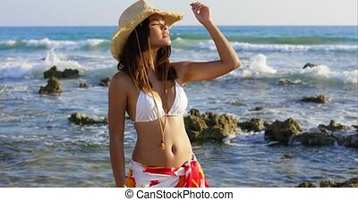 Smiling happy young woman on summer vacation posing at the...