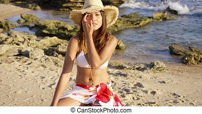 Beautiful woman in hat and bikini near ocean - Beautiful...