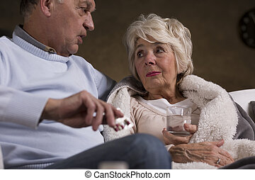 Taking care of his beloved one during her illness - Elderly...