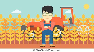 Man standing with combine on background - An asian farmer...
