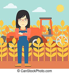 Woman standing with combine on background - An asian female...