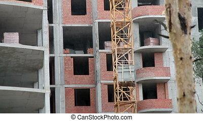 Building construction site - Crane at a construction site...