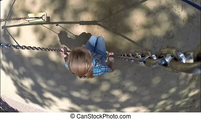 Young happy woman riding on a swing - Beautiful woman in...